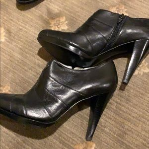 Black leather booties by Calvin Klein